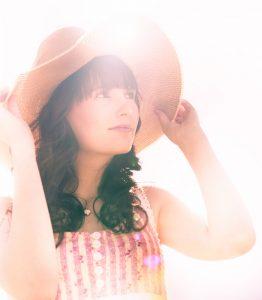 Sun Rays Beam Down On A Summer Woman In Summertime Hat And Dress In A Bright Happy Summer Portrait